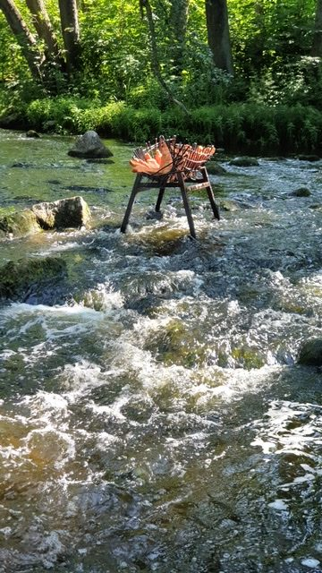 Photo of sculpture in a river