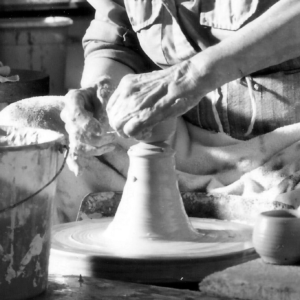 Hands working clay
