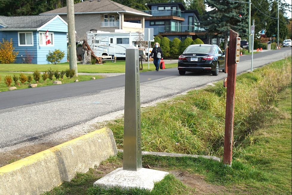 Roadside marker showing U.S. border
